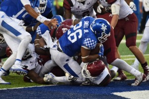 Freshman tailback Benny Snell scores one of a school record-tying four TDs