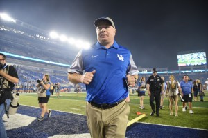 Mark Stoops jogs to the locker room, following UK's win over South Carolina (Photos by Brandon Turner)