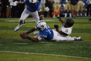 UK quarterback Stephen Johnson stretches for a key first down vs. Vanderbilt (photo by Brandon Turner)