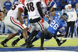UK tailback Benny Snell Jr. powers his way into the end zone for one of his two touchdowns vs. Georgia. The play originally was ruled short of the end zone; TV replay overturned the ruling. Photo by Chet White | UK Athletics