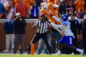 Tennessee QB Josh Dobbs leaps for the end zone during the Vols' win over the Wildcats (Photo by Brandon Turner)