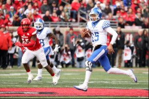 UK quarterback Stephen Johnson runs for a first down at Louisville (photo courtesy Chet White/UK Athletics)