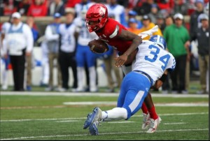 Linebacker Jordan Jones tackles U of L QB Lamar Jackson for a loss (photo courtesy Chet White/UK Athletics)