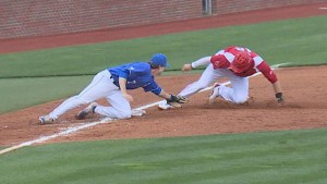 Connor Heady applies the tag at third, completing UK's triple play in Tuesday's win over Louisville (WKYT)