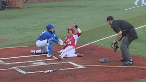 Troy Squires who, like Heady, is having his best season offensively, applies the tag at the plate before firing to third to complete the triple play (WKYT)