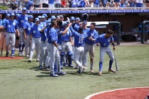 UK senior Marcus Carson is congratulated after one of his two home runs Sunday; first against Indiana, then NC State (UK Athletics)