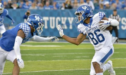 Mark Stoops, DeMarcus Harris and J.J. Weaver meet the media